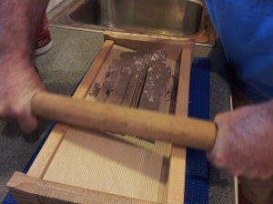 Cutting the pasta on the chitarra