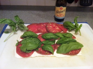 Here is our strip of mozzarella with the ingredients on it. The back row is the left over tomato and basil.