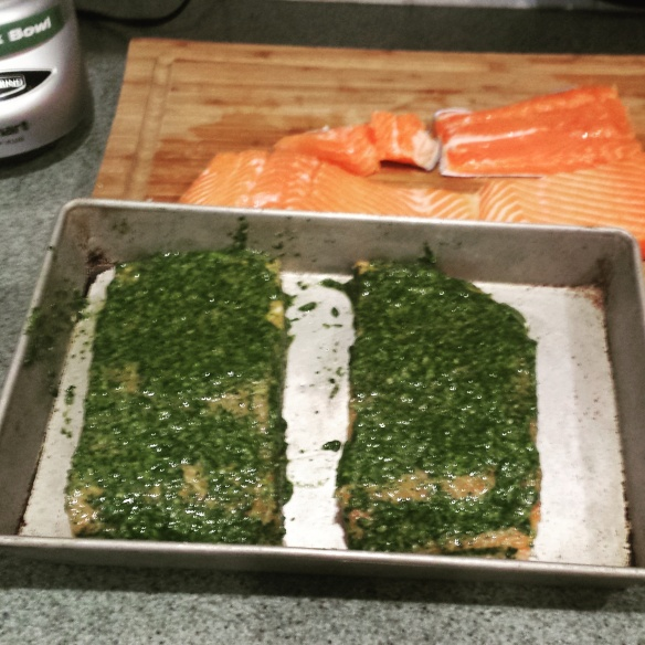 Salmon coated with basil and mint pesto