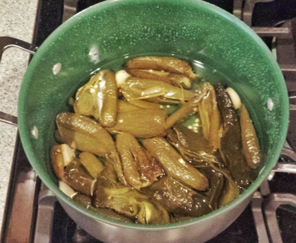 Peppers and garlic covered in water.