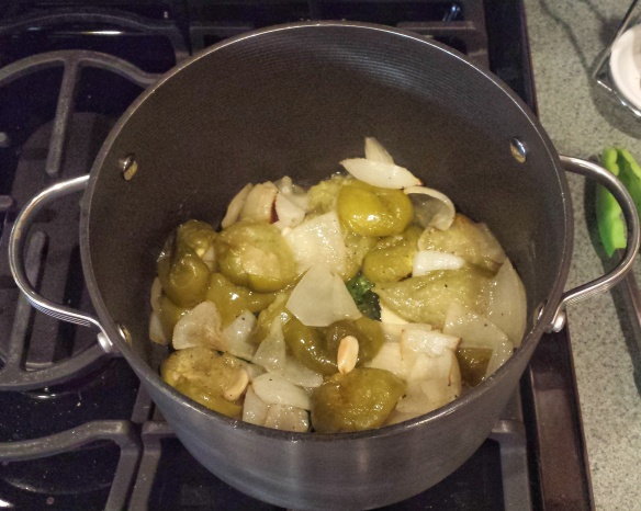 Tomatillos, onions, garlic and cilantro in our dutch oven.