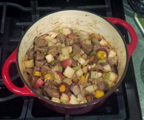 The beef has been added to the vegetables and spices.