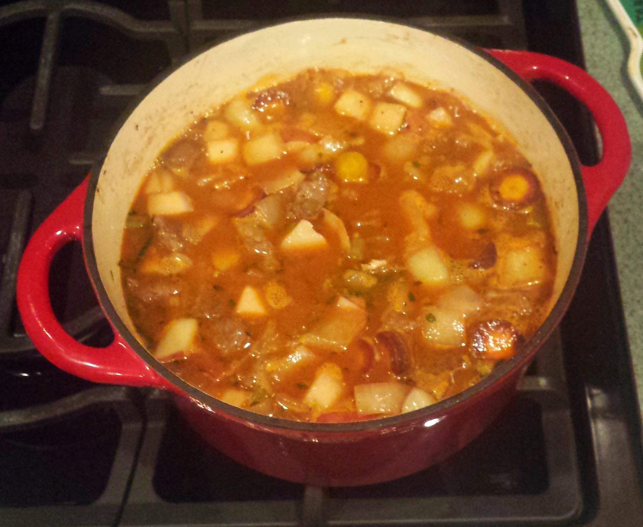The pot roast stew simmering in the dutch oven.