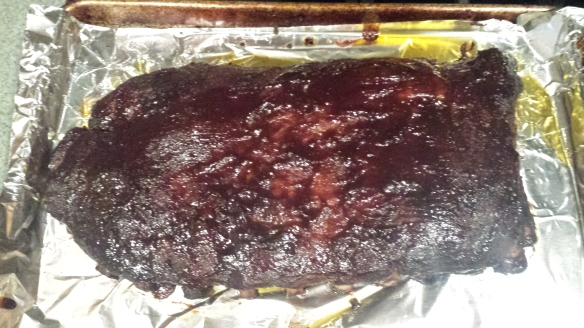 Here are our ribs after an hour in the oven with BBQ sauce on them.