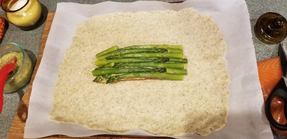 Asparagus spears on top of the cream sauce.